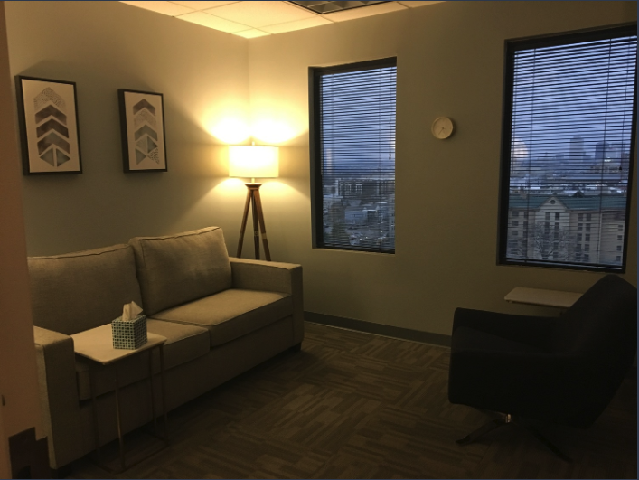 Stylish and cozy therapy room with view.